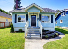 Blue American house exterior with concrete floor porch. Stock Images