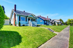 Blue American house exterior with concrete floor porch. Stock Image