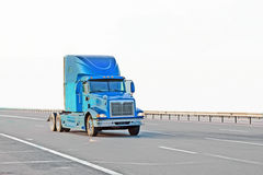 Blue american truck on road Stock Photography