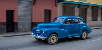 Blue American Vintage Car Driving through Havana royalty free stock photography