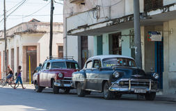Blue american vintage cars parked in series in the countryside from Cuba Royalty Free Stock Photography