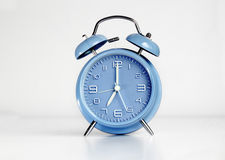 Blue analog retro twin bell alarm clock Stock Images