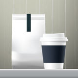 Blue anchor coffee cup and food paper bag breakfast set. On wood background Stock Images