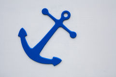 Blue anchor on white wall Royalty Free Stock Images
