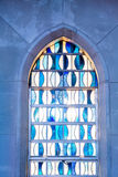 Blue And White Stained Glass In Arched Window Royalty Free Stock Photos