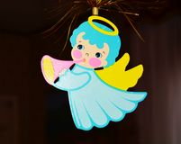 Blue angel and Christmas tree Stock Images