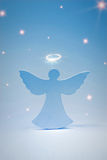 Blue angel and stars. On a blue background Stock Photography