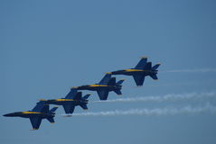 Blue Angels air display team. Blue angels military air display team flying in formation in blue sky Royalty Free Stock Photo