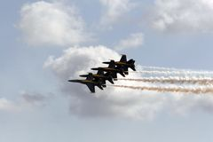 Blue Angels in the clouds. Two US Navy's Blue Angels flying high in the clouds. Jets are the FA-18 Hornet Royalty Free Stock Image