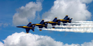 Blue Angels In The Clouds. The Navy's Blue Angels Flying In Very Tight Formation, Smoke On In The Clouds