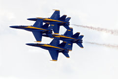 Blue Angels Diamond Formation. YPSILANTI - July 24th : The US Navy Blue Angels execute the diamond formation at the Thunder Over Michigan air show on July 24th Stock Image