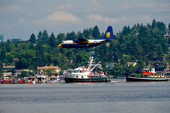 Blue Angels Fat Albert Seafair. The Blue Angels support plane Fat Albert flying over the log boom race crowd at Seafair Sunday on Lake Washington in seattle wa Royalty Free Stock Photos