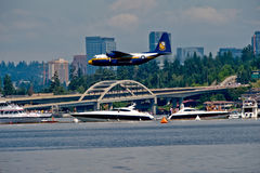 Blue Angels Fat Albert Seafair. The Blue Angels support plane Fat Albert flying over the log boom race crowd at Seafair Sunday on Lake Washington in seattle wa Royalty Free Stock Photo