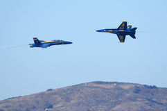 Blue Angels fly at each other Stock Images