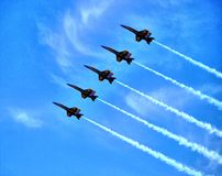 Blue Angels. Flying through the clouds Royalty Free Stock Photography