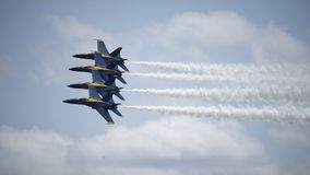 The Blue Angels flying in formation. The blue Angels flying at the Joint Base Andrews airshow in Maryland stock images