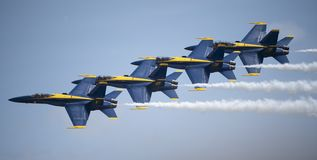 The Blue Angels flying in formation. The blue Angels flying at the Joint Base Andrews airshow in Maryland royalty free stock photography