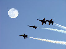 Blue Angels And Full Moon. The Navy's Flight Demonstration Team Streaks Towards A Full Moon royalty free stock photography