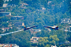 Blue Angels Head to Head. The Blue Angels Navy stunt performance plane flying over the log boom race crowd at Seafair Sunday on Lake Washington in seattle wa Stock Images
