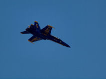 Blue Angels Jet flies above. SAN FRANCISCO - OCTOBER 10: Blue Angels Jet flies above with words US NAVY and number 5 visible underneath craft taken October 10 Stock Photo