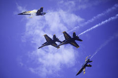 Blue Angels at Kaneohe Airshow. KANEOHE, HI - SEPTEMBER 30, 2012.  The U.S. Navy Blue Angels perform aerobatic manuevers on September 30, 2012 at the Kaneohe Bay Royalty Free Stock Photography