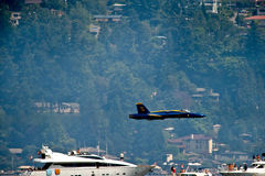 Blue Angels Low Pass. The Blue Angels Navy stunt performance plane flying over the log boom race crowd at Seafair Sunday on Lake Washington in seattle wa Royalty Free Stock Images