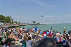 Blue Angels over Lake Michigan. 2012 Chicago Air and Water Show related. May be used to advertise for air shows stock photography