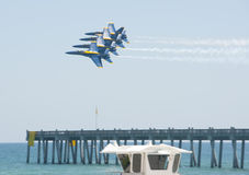 Blue Angels Pensacola Beach Airshow. PENSACOLA BEACH - 8 JULY: The U.S. Navy Blue Angels flight demonstration team perform over Pensacola Beach, Florida on July Stock Photos