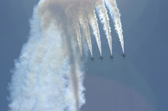 Blue Angels performs maneuvers. Above Lake Washington with Mt Rainier in the background Royalty Free Stock Photo
