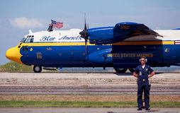 Blue Angels Transport Plane. The Blue Angels transport plane with Marine holding the flag Stock Photography