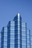 Blue Angled Office Tower on Deep Blue Sky Royalty Free Stock Photos