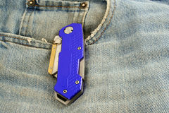 Blue anodized contractors razor knife on jeans Stock Images