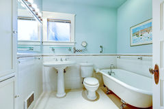 Blue antique elegant bathroom with white tub. Stock Photos