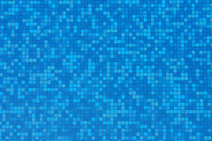 Blue and aqua mosaic tiles in swimming pool Stock Photos