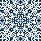 Blue Arabesque Pattern. Vector arabesque pattern. Seamless flourish background with dark blue floral elements. Intricate ornate lines. Arabic decorative design Royalty Free Stock Images