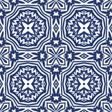 Blue Arabesque Pattern. Vector arabesque pattern. Seamless flourish background with dark blue floral elements. Intricate ornate lines. Arabic decorative design Stock Photography