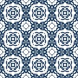 Blue Arabesque Pattern. Vector arabesque pattern. Seamless flourish background with dark blue forged elements. Intricate ornate lines. Arabic decorative design Stock Images