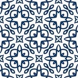 Blue Arabesque Pattern. Vector arabesque pattern. Seamless flourish background with dark blue floral elements. Intricate ornate lines. Arabic decorative design Stock Image