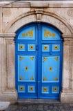 Blue arabic door. Picturesque blue arabic door in Tunisia Stock Photo