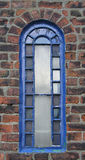 Blue Arched Window. This arched window is part odf a building in Whitby, UK royalty free stock images