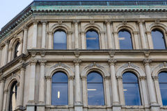 Blue Arched Windows in Old Stone Building Stock Image