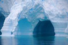 Blue arches of an iceberg Royalty Free Stock Photo