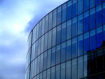 Blue architecture. Part of round shape building with sky in background royalty free stock photography