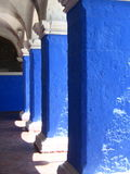 Blue Archways. Blue columns on a sunny day with sun and shadow Stock Photography