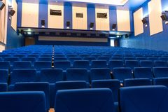 Blue arm-chairs in cinema Royalty Free Stock Image