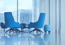 Blue arm chairs and footstool in a corner office. Small seat and modern blue office arm chairs in open space boardroom Stock Image
