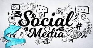 Blue arrow with black social media doodles against white wall Stock Photos