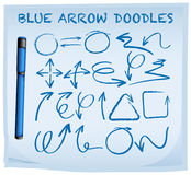 Blue arrow doodles on blue paper Royalty Free Stock Photography