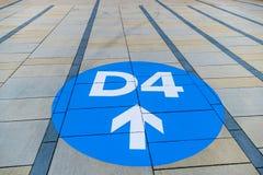 Blue arrow on pavement slabs Stock Image