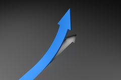 Blue arrow pointing up from surface Royalty Free Stock Photo